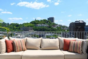 outdoor couch with city view behind it